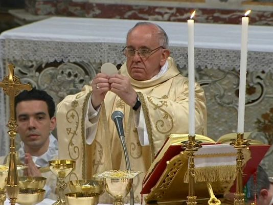 Image result for priest giving blessing eucharist