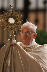 Pope Francis carrying Jesus in Monstrance