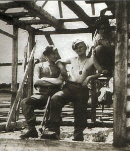 Young Karol Wojtya as a young factory worker and wearing a brown scapular.