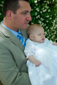 My Goddaugher/Niece and I on the day of her Baptism.
