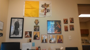 Papal Flag, JP2 picture, San Damiano Cross, Annunciation painting, the Blessed Virgin Mary, Icons of the Saints.