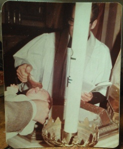 Being Baptized by Rev. Joseph Nativo at St. Lucy's Catholic Church in Newark, NJ on March 17, 1974.
