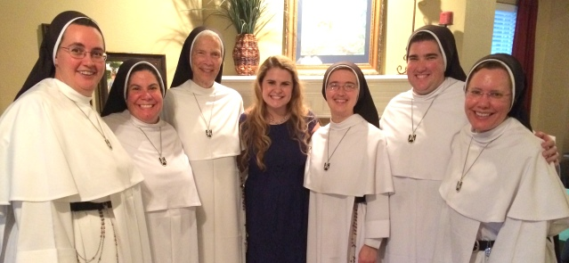Ava with some of the Dominican Sisters, including Mother Assumpta (left of Ava).