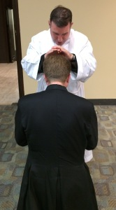 The newly ordained, Fr. Patrick, blessing Fr. Georg.
