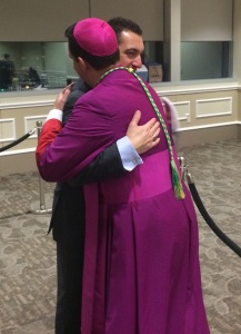 Embracing and wishing Bishop Lopes congratulations.