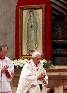 Pope Benedict XVI walks near an image of Our Lady of Guadalupe as celebrates Mass to mark the feast of Our Lady of Guadalupe in St. Peter's Basilica at the Vatican Dec. 12. During the liturgy the pope confirmed he will travel to Mexico and Cuba in the spring. (CNS photo/Paul Haring) (Dec. 12, 2011) See POPE-GUADALUPE Dec. 12, 2012.