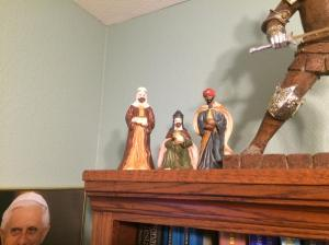 The Magi start on the top of my bookcase after talking with Pope Benedict and the Knight.